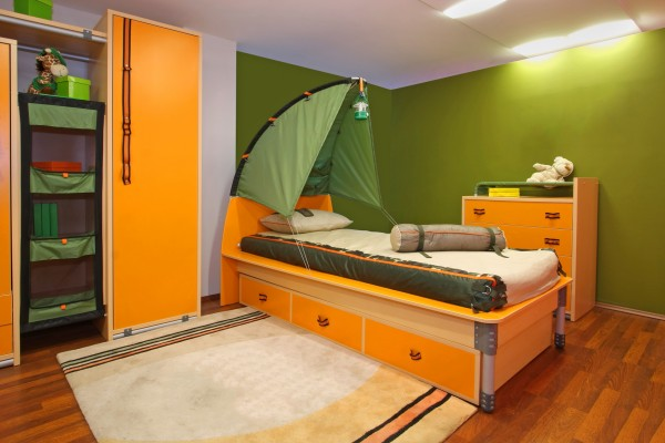 Green child bedroom interior with camping theme